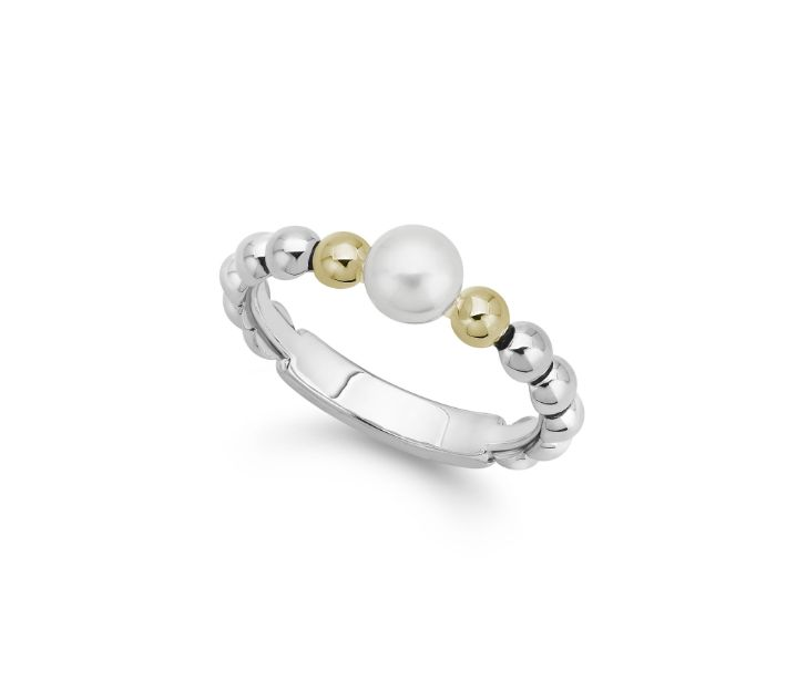 Front view of ring. A sterling silver beaded shank boasts a 5mm pearl in the center of the band with a single 18k yellow gold beaded accent on either side of the pearl.