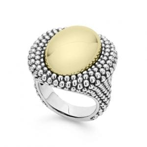 Front view of ring. A polished yellow gold, oval, domed center is haloed by a double layer of beaded sterling silver. Additional beaded details accent a thick, tapered shank.