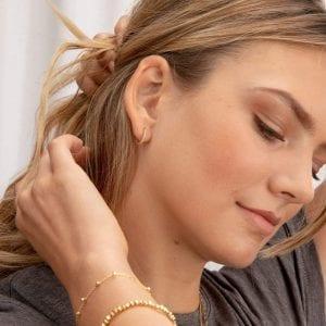 gorjana shimmer hoop huggie earrings on model