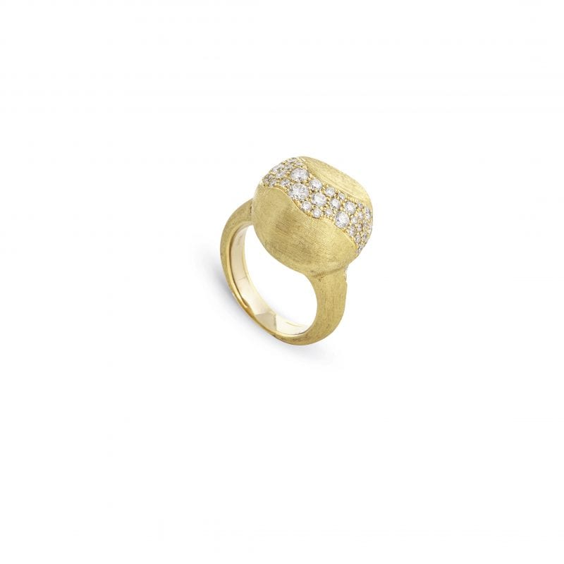 Front view of ring. A yellow gold hand engraved ring features a large center boule with various sized diamonds scattered across, like as a river of diamonds running through the middle