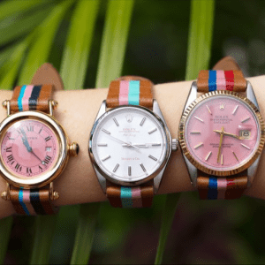 three watches with leather and multicolored bands