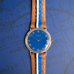 leather watch on blue background