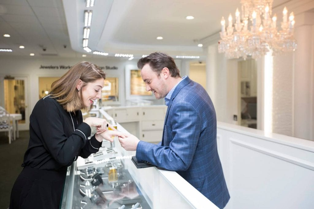 woman looking at a ring in a jewelry store