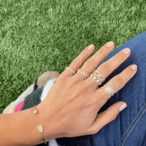 gold and diamond rings and bracelet on model