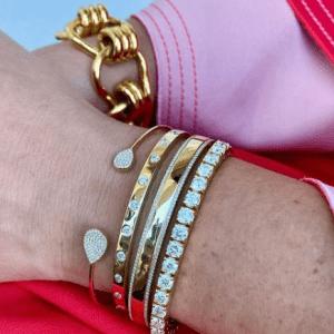 four diamond and gold bracelets on wrist