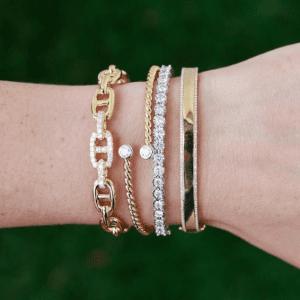 gold and diamond bracelets on wrist