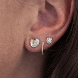 3 gold and diamond earrings worn on model