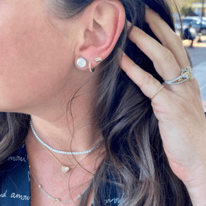 diamond and gold earrings, rings, and necklaces on model