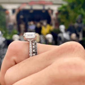 side view of stack of 3 diamond rings on finger