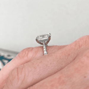 sideview of diamond ring on hand