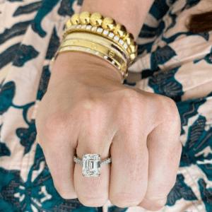diamond ring and gold bracelets on model