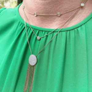 three gold and diamond necklaces on model