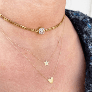 3 gold and diamond necklaces on model