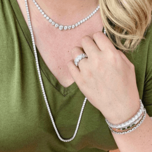 diamond rings bracelets and necklaces on model