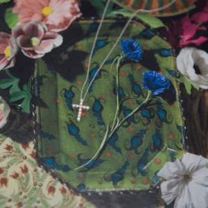 diamond cross necklace with floral background
