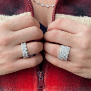 two diamond rings worn on ring fingers