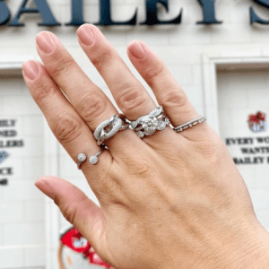 assorted diamond rings on model storefront background
