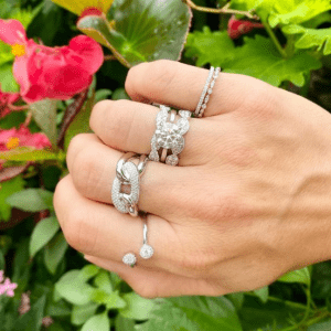 white gold and diamond rings on model
