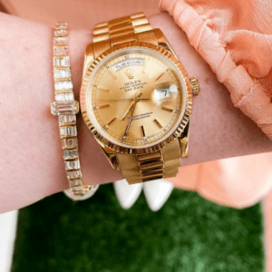 gold watch and gold and diamond bracelet