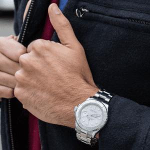 silver men's watch on model