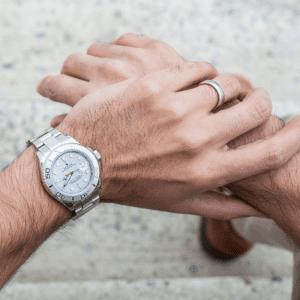 silver men's watch on wrist