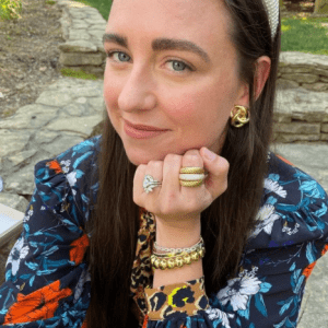 gold earrings and bracelets and gold and diamond rings on model
