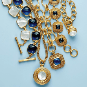 gold necklaces and bracelets with blue and white stones
