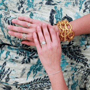 gold bracelets and diamond rings on model