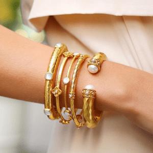 5 gold bangle bracelets with white stones