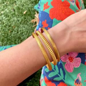 3 gold bracelets on wrist