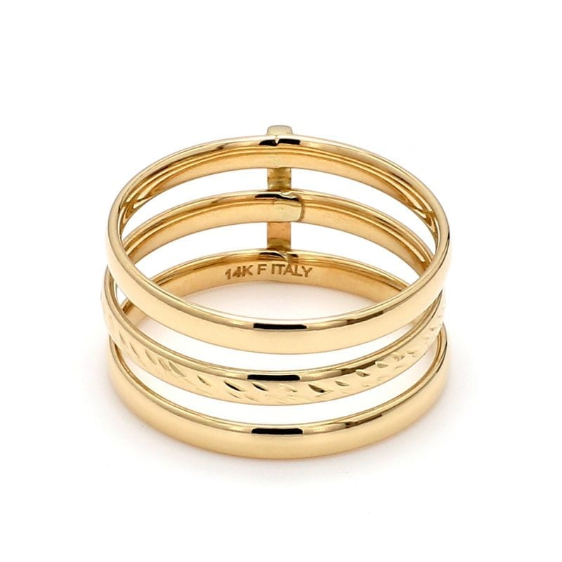 Front view of ring. Three bands of yellow gold are stacked with space in between each. The top and bottom band are polished and the center is textured. Secured in place by a vertical bar of yellow gold in the back.