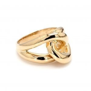 45 degree angle of ring. A polished yellow gold shank splits off into two loops that interlock creating a love knot motif in the front of the ring.