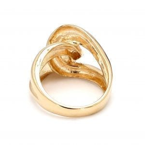 Back view of ring. A polished yellow gold shank splits off into two loops that interlock creating a love knot motif in the front of the ring.