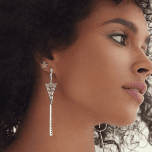 gold and silver earrings on model