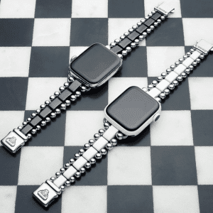 two black and silver watch bracelets on checker background