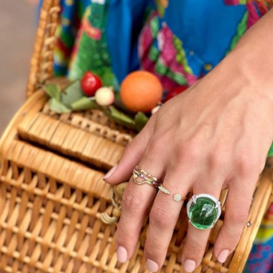 green and gold rings on model