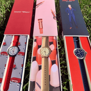red tan and blue watches in boxes