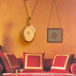 gold locket necklace on living room painting background