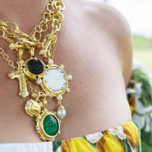 gold and colored stone necklaces on model