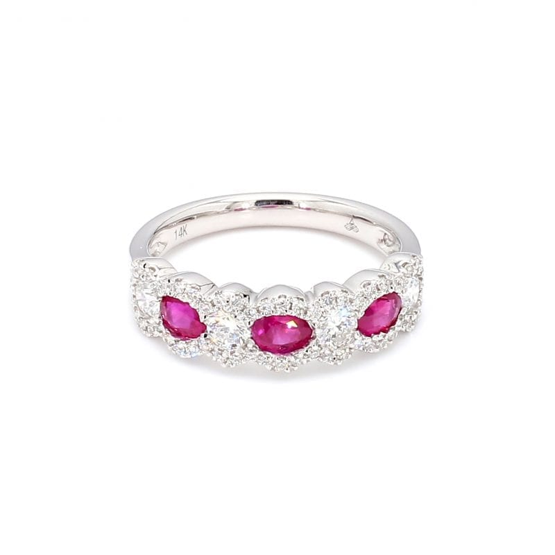 Front view of ring. Three oval cut rubies alternate with round brilliant cut diamonds along the front half of this band with pave diamond scalloped edges.