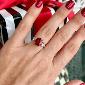 red and diamond ring on ring finger
