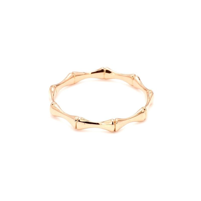 Back view of ring. A polished rose gold band is made up of small bamboo motif stations connected all the way around the ring.