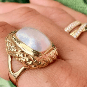 pearl and gold ring on finger