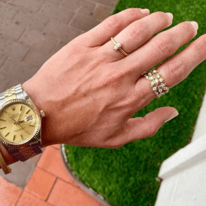 gold and diamond rings and silver and gold watch on model