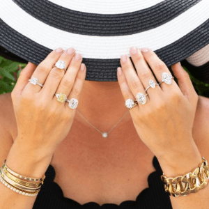 assorted diamond rings and gold bracelets on model
