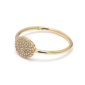 45 degree angle of ring. Pave diamonds accent an oval face attached to a simple, thin yellow gold shank.