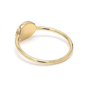 135 degree angle of ring. A thin, unadorned shank is attached to a polished yellow gold face.