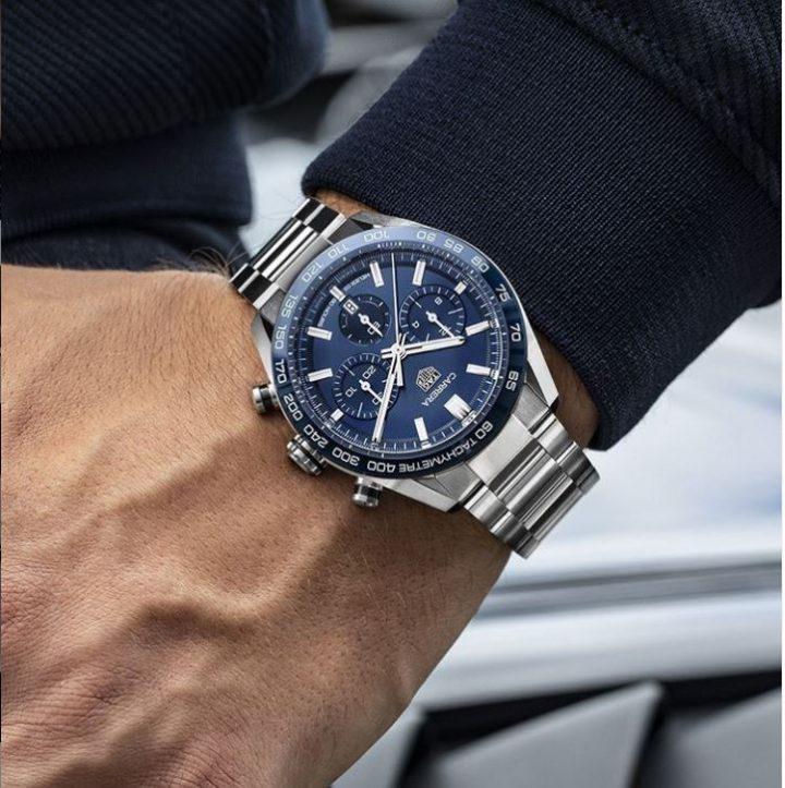 tag heuer TH watch on mans wrist