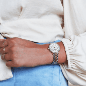 gold and silver watch on model