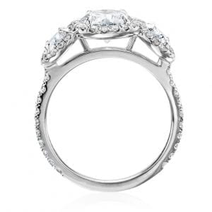 Engagament ring open ring view with three round diamonds each with thin diamond halo on white background